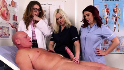 Clothed nurse tugs pole