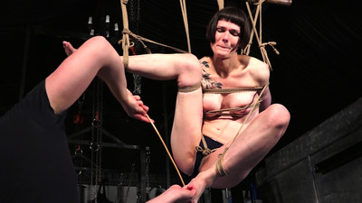 Tattooed suspension bondage..