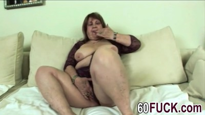 Hot granny is playing with..