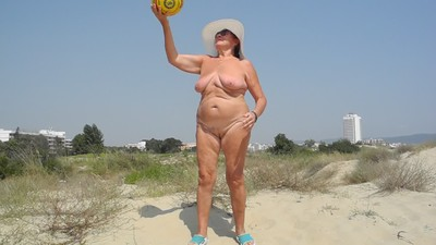 Nude on the beach ball