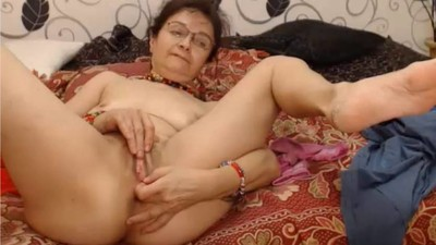 Hot grandma fingering her..