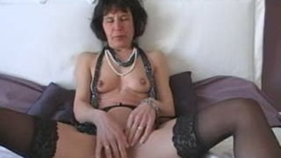 Mature with Dildo Does Herself