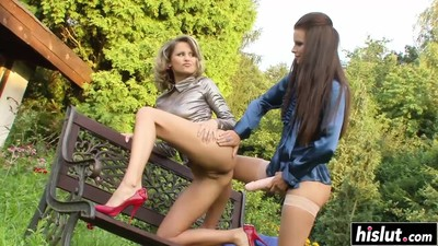 Two sluts and an outdoor bench