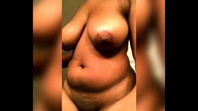 Huge ebony boobs coated in a..